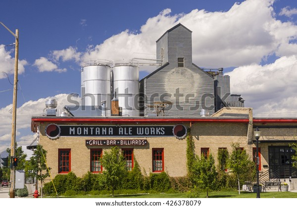 BOZEMAN, MONTANA, USA - AUGUST 2004: Montana Ale Works microbrewery, with grain elevators at rear.