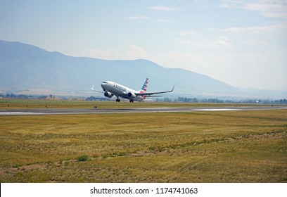 BOZEMAN, MT -7 SEP 2018- View of a plane from American Airlines (AA) taking off at the Bozeman Yellowstone International Airport (BZN), in Gallatin County, Montana near Yellowstone National Park.