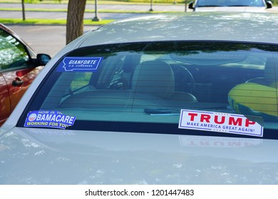 BOZEMAN, MT -7 SEP 2018- View of a car window with Republican political bumper stickers for Trump Make America Great Again and Gianforte for Congress in Bozeman, Montana.