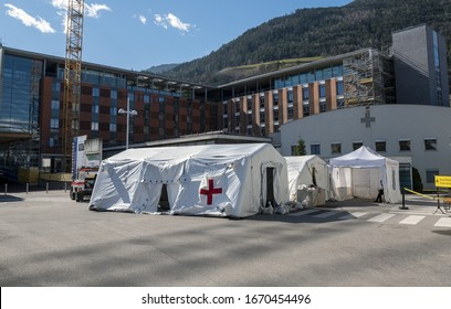 BOZEN, ITALY - MARCH 11, 2020. Hospital field tent for the first AID, a mobile medical unit of red cross for patient with Corona Virus. Camp room  for people infected with the 2019-Ncov or Covid-19.