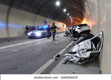 BOZEN, ITALY - March 3, 2020: Police and firefighters at work for the reconstruction and reliefs of the fatal accident. Terrifying deadly car crash accident after a frontal collision inside a tunnel.