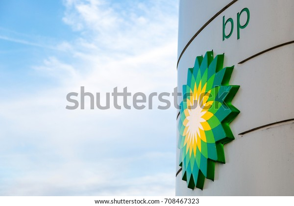 BP display stand with company redesign logo at petrol station in Woking, Surrey, UK. State per 06/05/2016