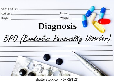 BPD (Borderline Personality Disorder) - Diagnosis written on a piece of white paper with medication and Pills