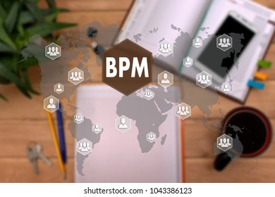 BPM. Business Process Management  on the touch screen to the network, on office background blur.Concept of Business Process Management