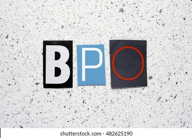 BPO (Business Process Outsourcing) acronym cut from newspaper on white handmade paper texture