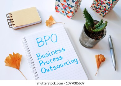 BPO Business Process Outsourcing written in notebook on white table