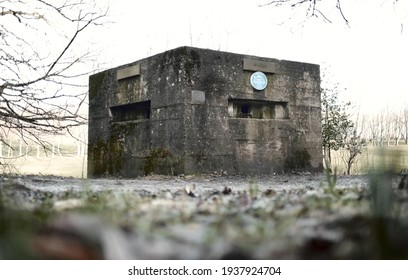 bpool, uk 02.02.2021 A brutalist cold gritty concrete world war two, ww2, pillbox war bunker defence fortress in a dirty forgotten woodland in europe. wartime relics and forgotten outposts
