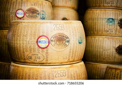 BRA, ITALY - SEPTEMBER 18, 2017: Many Parmiggiano Reggiano (typical italian cheese) wheels stacked toghether in Bra (Piedmont, Italy) on september 18,2017