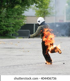 Brabant, the Netherlands - May 13, 2012: running stuntman on fire