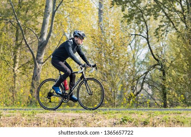 BRABANT-APRIL 7, 2019. Cycle runner is training on a spring day in a green environment. In the southern part of the Netherlands like Brabant Province, road cycling and sport cycling are very popular.