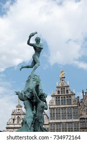 Brabo Fountain in the town square, Grote Markt, in the centre of Antwerp, Belgium with the Antwerp City Hall (Stadhuis van Antwerpen) behind.