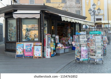 Bracciano, Italy - July 31, 2018: Newsagent's shop exterior, newsstands full of foreign daily newspapers