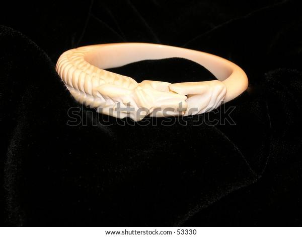 bracelet  hand carved snake. Isolated black background