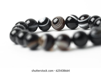 bracelet made of natural stones on a white background