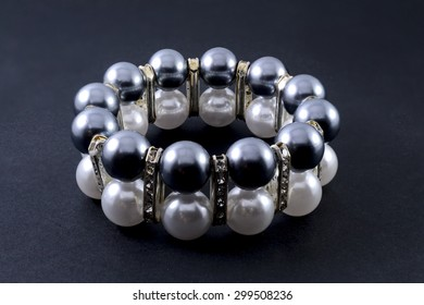 bracelet with pearls isolated on black