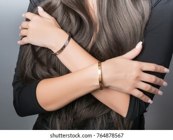 Bracelet set on a hand with French manicure, jewelry on a model