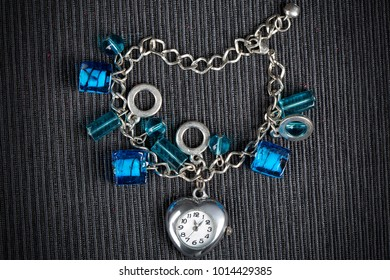 A bracelet with watch in shape of heart