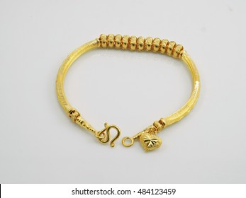 bracelet yellow gold with pendant heart