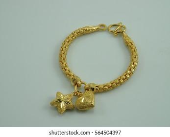bracelet yellow gold star heart pendant