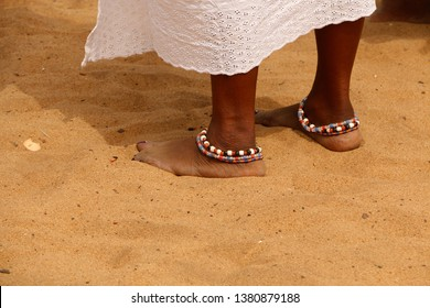 bracelets around the ankles, anklets of glass pearls