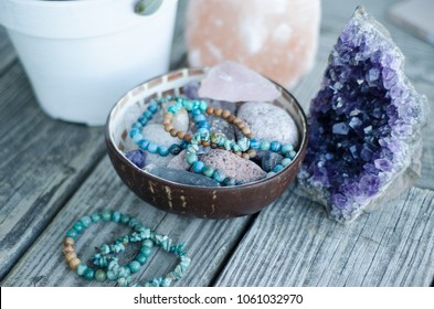 bracelets with herbs on wooden table outdoors