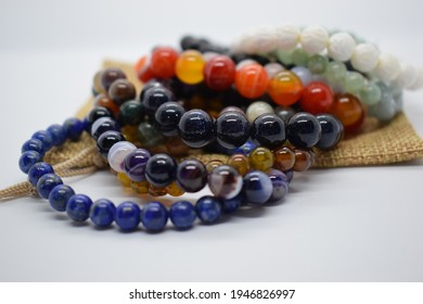 Bracelets made of natural stones. natural mineral texture of the necklace. The background is blurred. not everything is in focus.