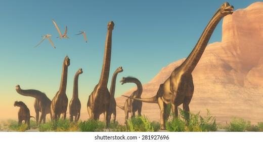 Brachiosaurus Afternoon - Three Pteranodon flying reptiles watch as a herd of Brachiosaurus dinosaurs travel near a canyon mountain.