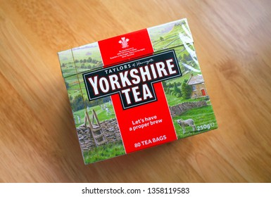 Bracknell, England - April 03, 2019: Unopened box of Yorkshire Tea bags on a wooden table top. Taylors of Harrogate have been providing tea in England since 1886