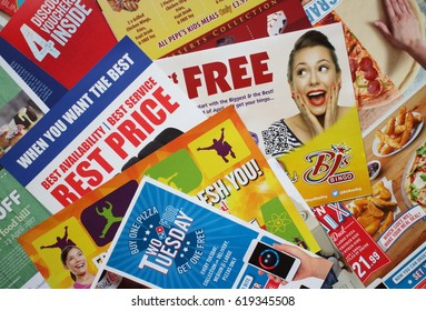 Bracknell, England - April 11, 2017: Sample of leaflets and brochures or Junk Mail delivered to a private address in Bracknell, England to advertise local retail and service businesses