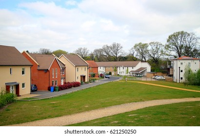 Bracknell, England - April 12, 2017: A variety of contemporary home styles on a modern housing estate with a green space out front in Bracknell, England