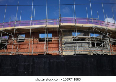 Bracknell, England - April 16, 2018: Scaffolding on the outside of an apartment block of new homes under construction in Bracknell, England