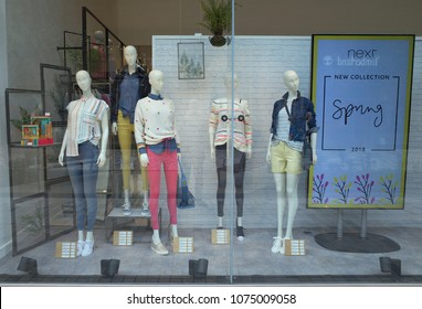 Bracknell, England - April 23, 2018: Window display of Spring fashion clothing for women in the Next retail store situated in Bracknell, England