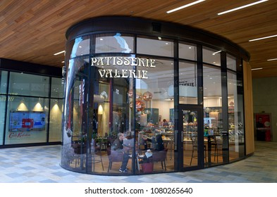 Bracknell, England - April 30, 2018: People inside Patisserie Valerie located in Bracknell, England. The chain of cafes specializes in hand-made cakes, teas and coffees