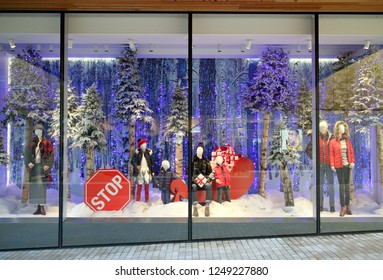 Bracknell, England - December 04, 2018: Winter clothing in the Christmas season, window display of Fenwick department store in Bracknell, England