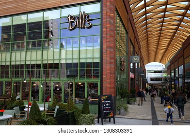 Bracknell, England - February 09, 2019: The exterior of Bill's Cafe with people passing by in Bracknell, England. Bill's is a British cafe chain founded by Bill Collison in 2000