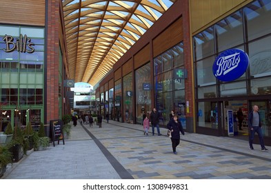 Bracknell, England - February 09, 2019: A view along one of the main shopping thoroughfares with pedestrians passing by, in the town center or Bracknell, England