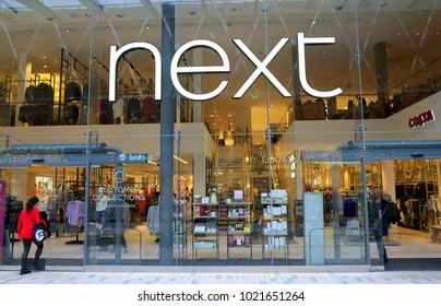 Bracknell, England - February 10, 2018: People entering the Next retail store in Bracknell, England. Launched in 1982, Next is a fashion clothing and home furnishing business
