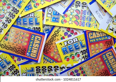 Bracknell, England - February 14, 2018: Random selection of lottery scratch cards for cash prizes to be won in British Pounds. Photographed in Bracknell, England