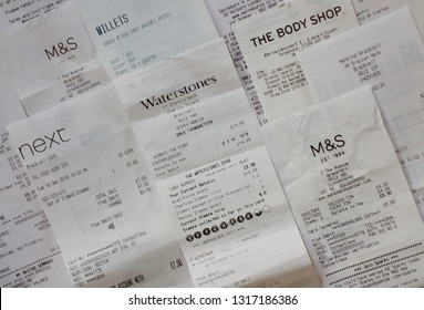 Bracknell, England - February 19, 2019: A selection of shopping receipts for various branded retail stores in England