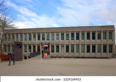 Bracknell, England - February 20, 2018: A man is seen leaving the concrete Central Library building in Bracknell, England. The library was constructed in the 1970's