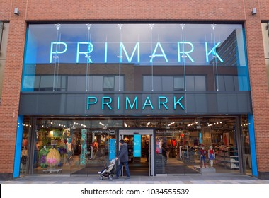Bracknell, England - February 27, 2018: A man with a child in a pram exits the Primark clothing store in Bracknell, England. Primark opened their first UK store in Derby in 1973