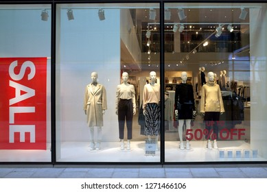 Bracknell, England - January 01, 2019: Display of mannequins wearing female fashion clothing, with a sale banner in the window of the H & M store in Bracknell, England
