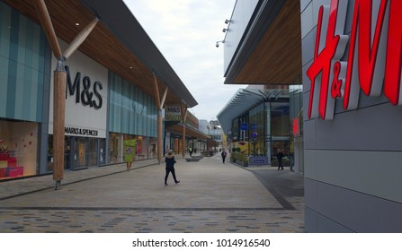 Bracknell, England - January 31, 2018: Wide angle view of pedestrians and retail stores along The Avenue, part of the new Lexicon shopping center in Bracknell, England