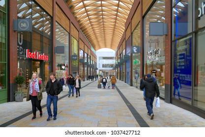 Bracknell, England - March 03, 2018: Wide angle view of people walking along one of the main thoroughfares of the new Lexicon Shopping Center in Bracknell, England
