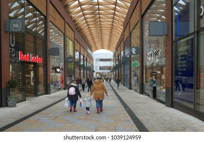 Bracknell, England - March 03, 2018: View of people walking by the shops and businesses along Braccan Walk, one of the main thoroughfares of the new Lexicon Shopping Center in Bracknell, England