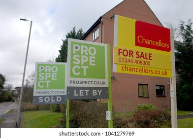 Bracknell, England - March 08, 2018: Estate Agent signs advertising property For Sale, Sold or To Let in front of an apartment block in Bracknell, England