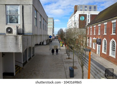 Bracknell, England - March 11, 2018: A view of old and modern buildings along the High Street with pedestrians, in the business and shopping district of Bracknell Town Centre, England