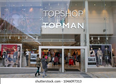 Bracknell, England - March 14, 2018: People entering the new Topman and Topshop fashion clothing store in Bracknell, England