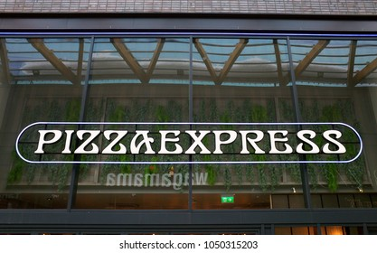 Bracknell, England - March 20, 2018: The Pizza Express sign above the entrance to their restaurant in Bracknell, England. Pizza Express opened their first restaurant in London in 1965