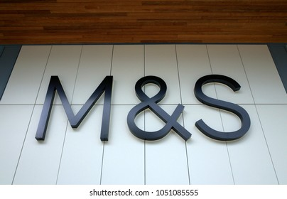 Bracknell, England - March 20, 2018: The M & S logo above the entrance to the Marks and Spencer store in Bracknell, England. M & S retails clothing, groceries and home furnishings across the UK